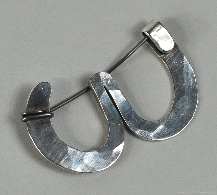 Calder sterling brooch, $22,140, Woodbury