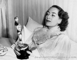 Joan Crawford's Oscar is auctioned for $426K.