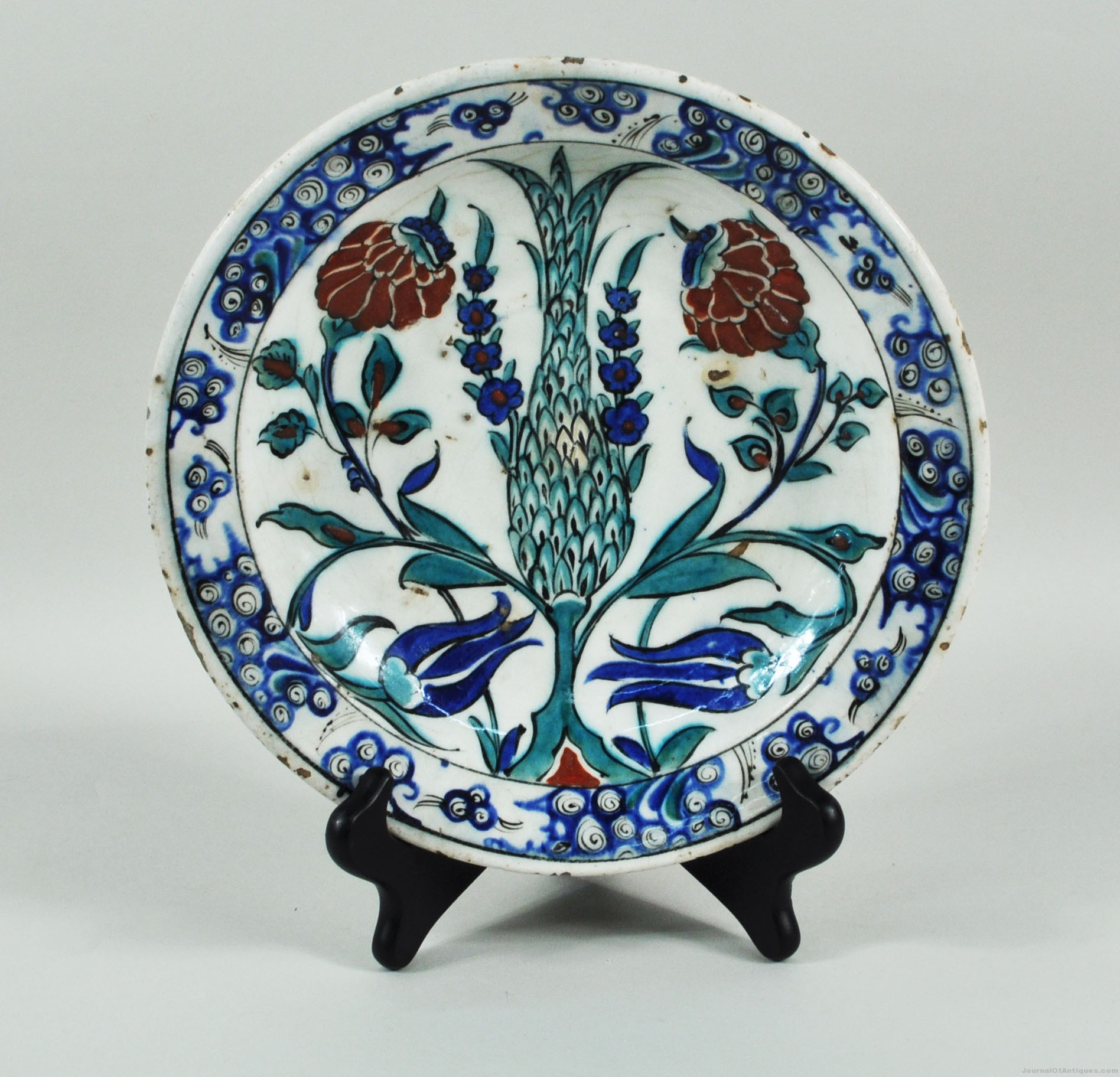 Iznik pottery charger, $9,600, Woodbury Auction