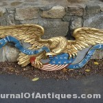 Carved eagle with gilt trim, $8,100, Tim's, Inc. Auctions