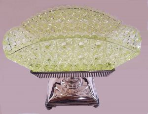 "Not your traditional shape: rectangular Vaseline glass basket. 11"" longest side, $550-$600."