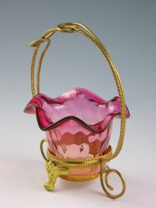 "Tiny amberina glass basket, 3-1/2"" d, $150-$200."