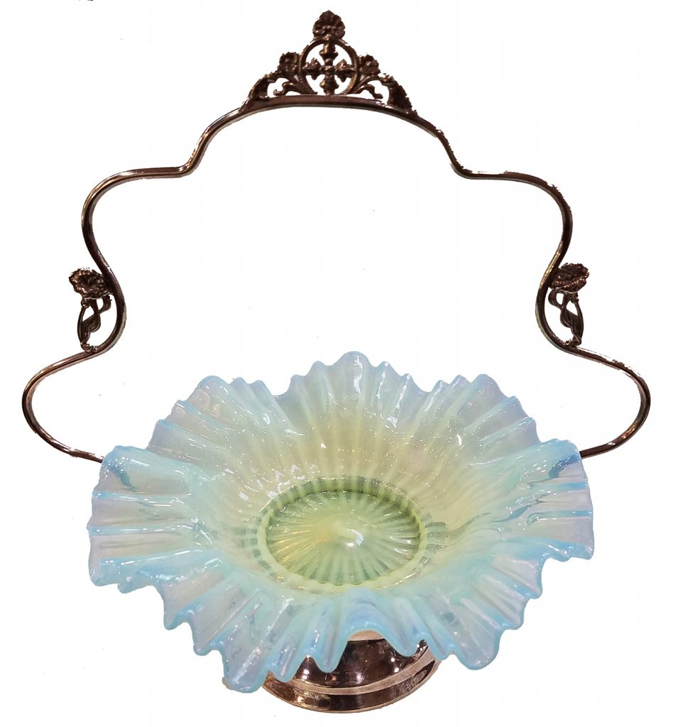 "Metal floral accent trim on handle highlights a pale blue basket. 10-1/2"" w, $1,300-$1,500."