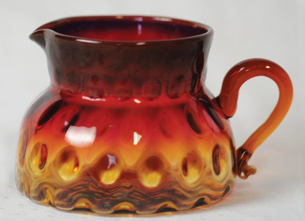 Mt. Washington rose amber glass in optic squat pitcher form, circa 1885