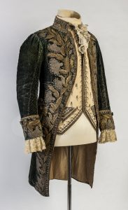 Man's coat and waistcoat, green woven velvet, cream silk, metallic-thread embroidery, glass-paste stones. France, about 1780.
