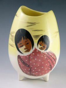 "Matthew Adams vase, Native Alaskan mother and child, 9"" h, $50-$75"