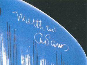 At right: Matthew Adams signature (Photo by Leslie Piña)
