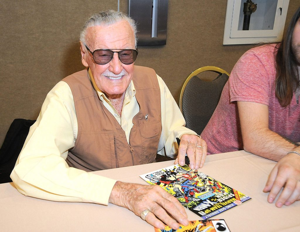 """Stan Lee at an autographing event. """"I would write the stories, and hope the public would buy them and like them, and then I'd be able to pay the rent. I never really spent time thinking how long will that last, because I knew if the character became unpopular, I can always write another one. I was always writing other ones."""""""