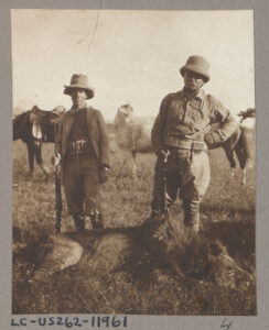 Theodore Roosevelt, right, stands next to a lion killed on safari. photo: Library of Congress
