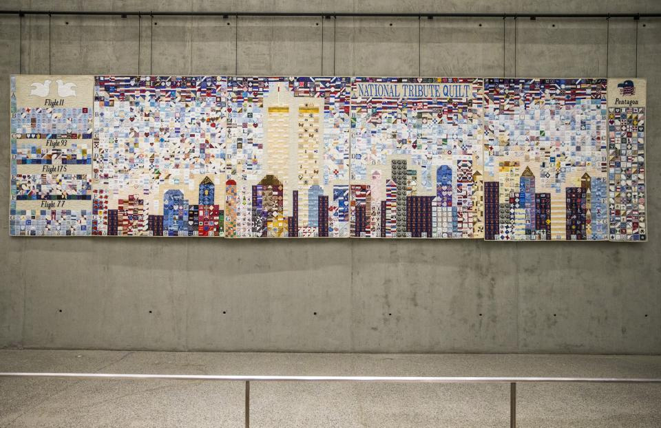 The National Tribute Quilt hangs in the 9/11 Memorial Museum's Tribute Walk. Photo by Jin Lee.