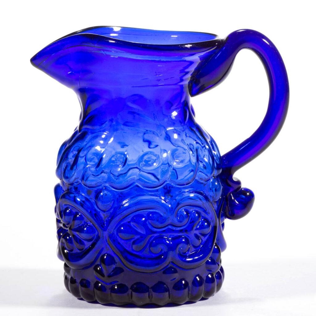 Blown-molded cream jug