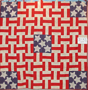 Civil War Memorial Quilt from the Quilt Index and the Massachusetts project. Each of the white strips and the stars are inscribed with the name of a Massachusetts soldier, his company and the date he enlisted.