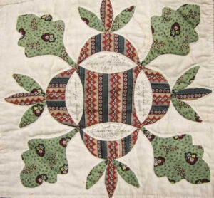 Oak Reel block dated 1846, Enoch and Mary Worrall quilt, dated 1850. (Starley Quilt Collection)