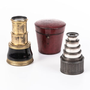 Miniature Dollond Monoculars, London, a 2-inch diameter black composite and gilt two-draw monocular housed in its original red leather fitted case, and a 1 1/2 inch dia. five-draw silvered monocular realized $438 at auction in 2020 photo: skinnerinc.com