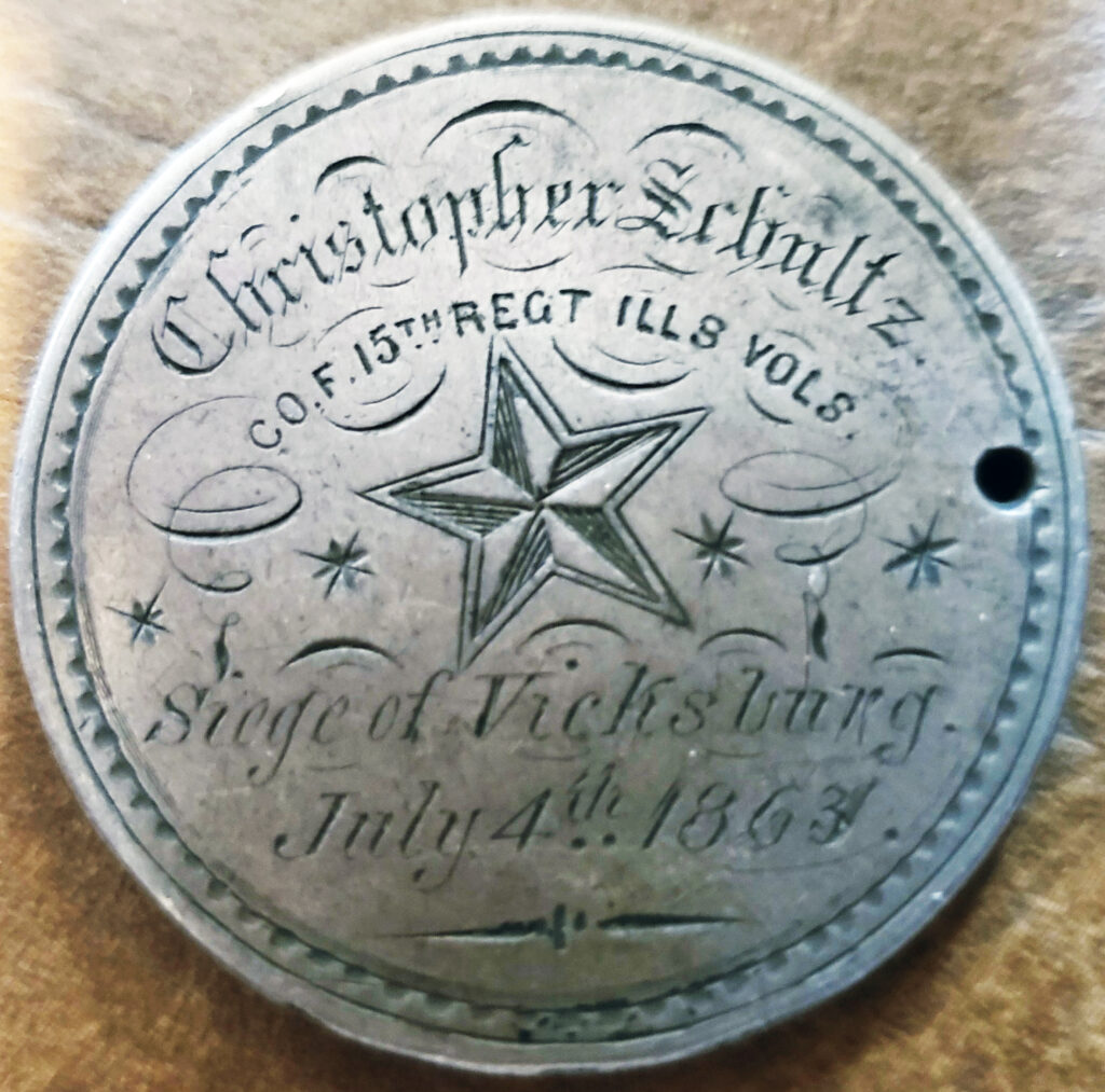 An 1859 silver dollar coin inscribed as ID for Christopher Schultz, $2,000 to $3,000.