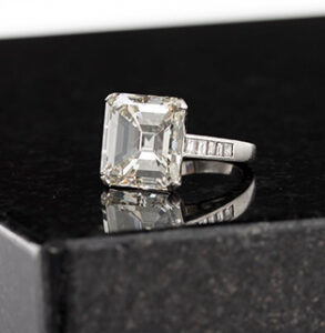 A dazzling 12.01-carat emerald cut diamond (K VVS1) and platinum ring slipped on a new finger for $143,750 in an inaugural Fine Jewelry, Watches & Timepieces auction held online-only, September 16, by Andrew Jones Auctions in Los Angeles, CA