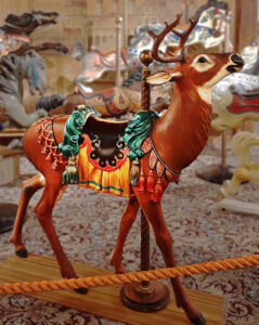 Country Fair-style figures on portable carousels were usually light, compact, and  simply  decorated, as they had to be easy to transport. However, some larger and more ornate figures were produced by the same  factories on occasion, like this deer with real antlers, carved on special order at the Allan Herschell factory of  North Tonawanda, NY in 1922.