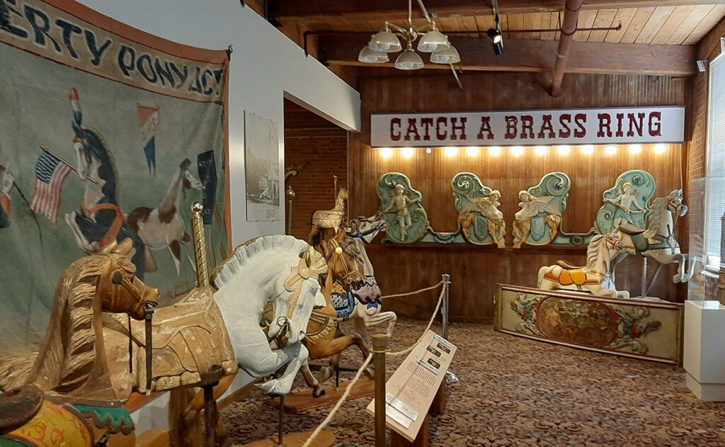 The front section of the New England Carousel Museum gives visitors  an introduction to the three distinct styles of American carousel art:  Country Fair, Philadelphia, and Coney Island.