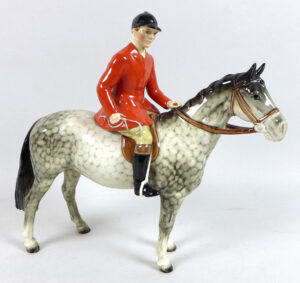 "This Huntsman, model 1501, stamped ""Beswick England"" appeared at Batemans of Stamford in August 2019 and sold to a collector for $1,300 (with a few condition issues). Designed by Arthur Gredington, the standard chestnut version of this model is not hard to find but this dappled grey, issued from 1958-62, is one of the rarer Beswick models. In 2006, a similar model in good condition sold for $4,600."