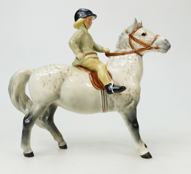 Rare Beswick model of a girl on grey pony 1499 with light green jacket – top auction estimate was $1,000, sold for $1,600 in 2018.