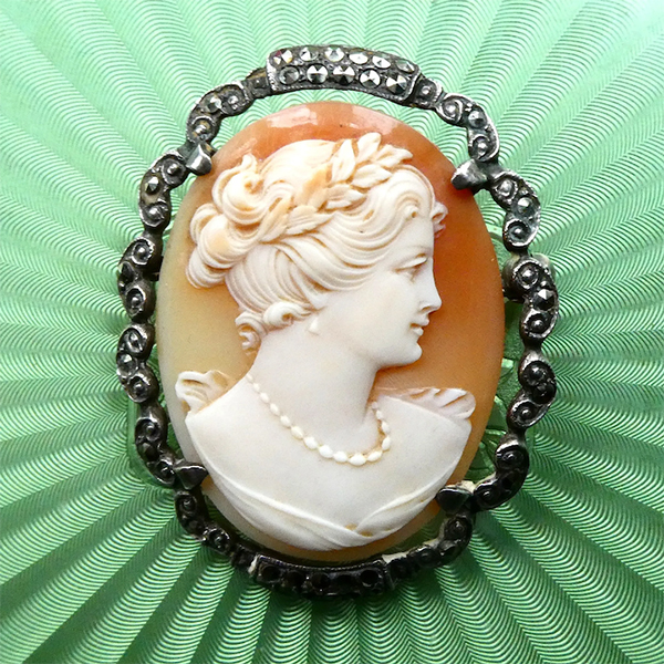 Cameos come in all sizes, forms, materials, subjects, and colors. This is an example of a carnelian shell cameo brooch