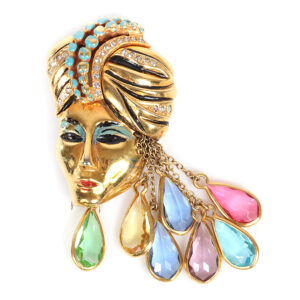 Eisenberg Originals gold-plated Sinbad figural fur clip with turbaned head with pave and enamel detailing and multi-colored teardrop framed rhinestone dangles, circa 1940. Sold for $1,250