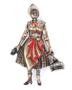 Eisenberg Originals sterling vermeil figural cleaning woman with bucket and brush figural pin clip with carved details, accented with red enamel and rhinestones, mid-1940s. Sold for $1,500