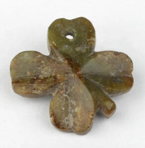 Marble four-leaf clover lucky charm belonging to an unknown soldier. photo:slate.com