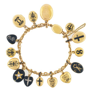 A gold charm bracelet with sixteen  various oval and heart shaped lockets, enamelled in black on gold. Some set with jewels, others engraved, several with inscriptions. One containing a miniature  photograph of male head. This bracelet was worn  constantly by Queen Victoria. photo: Royal Collection Trust