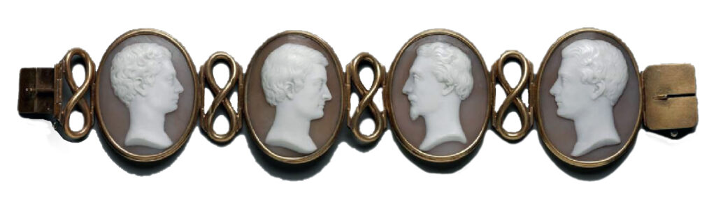 Four shell cameo portraits of the Hunt brothers bezel-set in gold, joined by figure-eight links, completed by a box clasp, c. about 1840 photo: Boston Fine Arts Museum