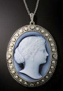 Title image: The profile of a striking classical beauty is masterfully hand carved in white onyx, highlighted by a subtle black aura, in this exquisite Edwardian pendant necklace. The cameo is elegantly presented in a delicate frame, hand fabricated in platinum over 18K yellow gold, dotted all around with lustrous natural seed pearls and four European-cut diamonds. A romantic and ravishing early-20th-century treasure. photo: Lang Antiques