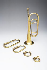 Bugle in G made in the early 19th century. During the War of 1812, there was a variety of shapes and sizes of the bugle. Typical shapes included the coiled, half-moon, and the elongated coil similar to the one shown. During the war, the bugle was included in the major U.S. military music ensembles. photo: Yale School of Music