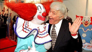 Harmon with a Bozo performer in 1996