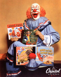 Pinto Colvig, the original Bozo the Clown, surrounded by Bozo merchandise