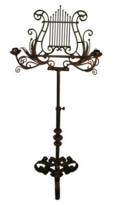 19th century hand wrought music stand with candle holders selling on 1st dibs for $2,195