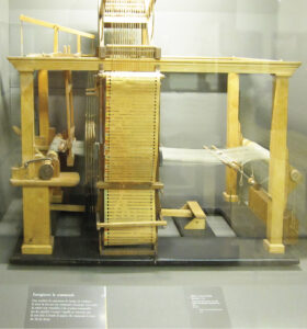 A 1725 Basile Bouchon loom on exhibit at the Metiers Museum in Paris.