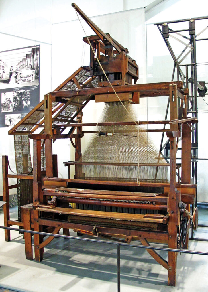 A carpet loom by Carl Engel with a Jacquard machine on top, ca. 1860. Photo by Dmm2va7; CC BY-SA 3.0