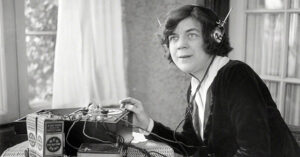 Woman using a crystal radio in the 1920s