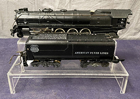 An American Flyer S gauge smoke-in-tender Northern 332 steam locomotive, 1946 or 1947, with a bronze brake tank, sold for $5,400 at a Toy & Train auction held February 24th by Weiss Auctions in Lynbrook, NY.