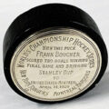 A hockey puck used in the final Stanley Cup championship game of 1928, won by the New York Rangers over the Montreal Maroons, 2-1, with Frank Boucher scoring both goals for the Rangers, sold for $66,000 in an online Sports, Non-Sports, Pulps, Comics & Comic Art auction held April 14th by Weiss Auctions in Lynbrook, NY