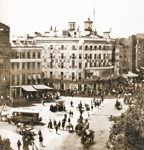 Barnum's American Museum in 1858 at the corner of Broadway, Park Row, and Ann Street where it stood before moving up the block to the corner of Fulton Street.