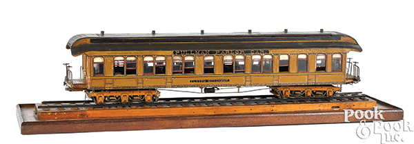 """In 2018, Pook & Pook sold a model of the Flying Dutchman parlor rail car for $5,600. Exceptional handmade wooden model of theFlying Dutchman Pullman Parlor Car, exhibiting an amazing level of detail from the intricately painted exterior to the finely carpeted and wallpapered interior, furnished with velvet upholstered swivel seats, spittoons, and a convenient lavatory visible through glazed windows and removable roof, 30 1/2"""" l. Pullman, who was more famous for sleeping cars, produced parlor cars from the 1880's through the 1960's. This model exemplifies their production from the Gilded Age."""