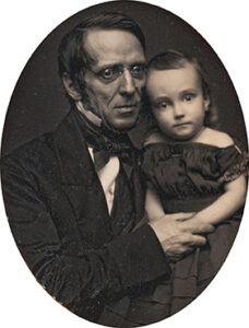 Peter Cooper posed with a young child believed to be one of his granddaughters