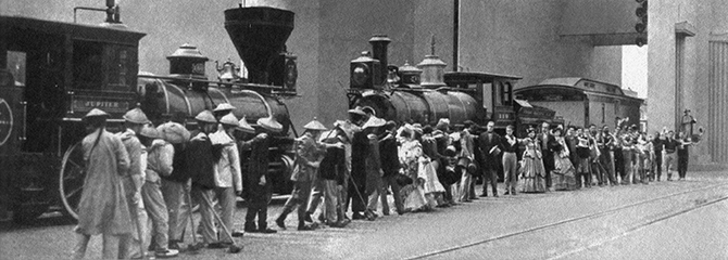 """At left: """"The Wedding of the Rails"""" pageant re-enactment of the 1869 driving of the last spike at Promontory Point, Utah, as the Pacific Railroad is finished."""
