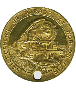 A souvenir of the day: a brass token heralding Railroads On Parade. The token reverse has an image of the Statue of Liberty.