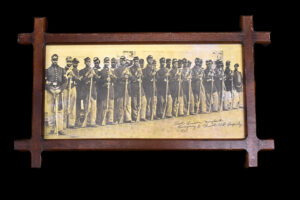 Black Civil War Military Photo, located at Fort Lincoln, Maryland, 1864, company E. Fourth US Infantry, in Tramp Art Frame (offered at auction by Heartland Artifact Auctions, Inc.)