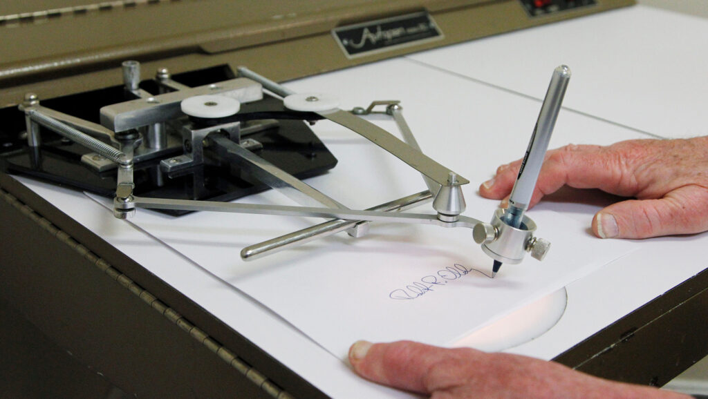 This 2011 photo depicts Bob Olding of Damilic Corp, a leading present-day manufacturer of signature machines, demonstrating the vintage Autopen Model 80. The machine uses levers and your favorite pen to duplicate programmed signatures, and while this can be a lifesaver for public officials, many in the government still use it sparingly. Though President Bush received a Justice Department Ruling in 2005 to sign a bill via autopen, he opted not to, and went out of his way to sign in person. Photo: via USA Today and Damilic Corp, Associated Press, 2011
